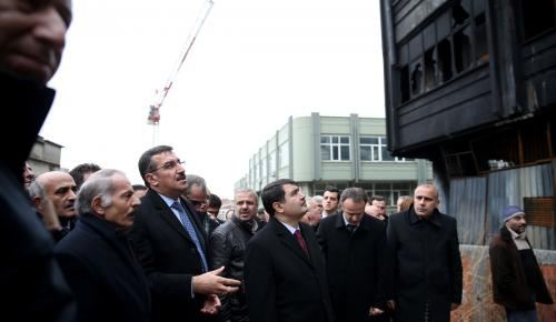 Bakan Tüfenkci iş yerleri yanan esnafı ziyaret etti